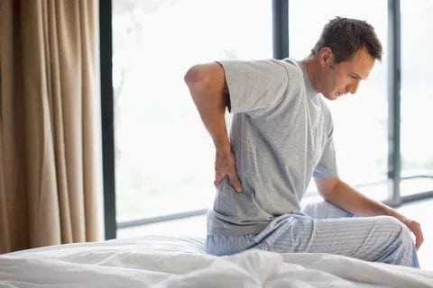 back pain alone man