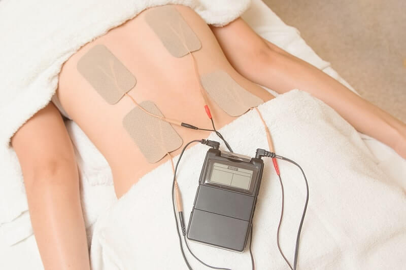Electrodes of tens device on back muscle
