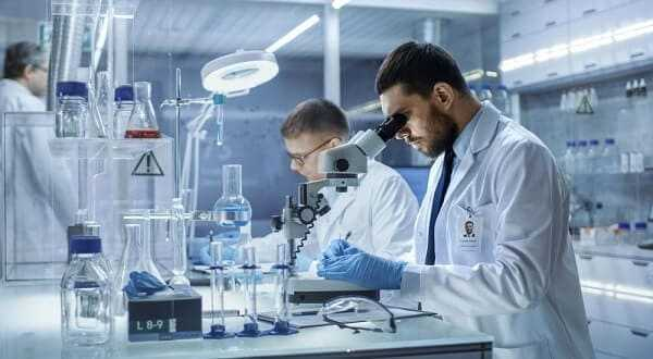 In a Modern Laboratory Two Scientists Conduct Experiments