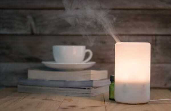 Ultrasonic humidifier on a wooden table
