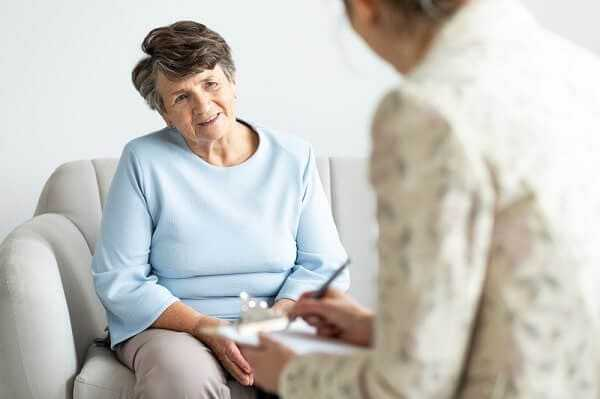 excited grandmother talking psychologist about positive
