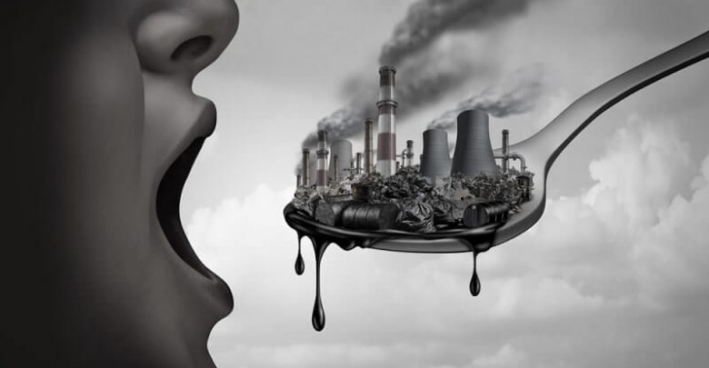 pollution and toxic pollutants inside the human body and eating contaminated food as an open mouth ingesting industrial toxins