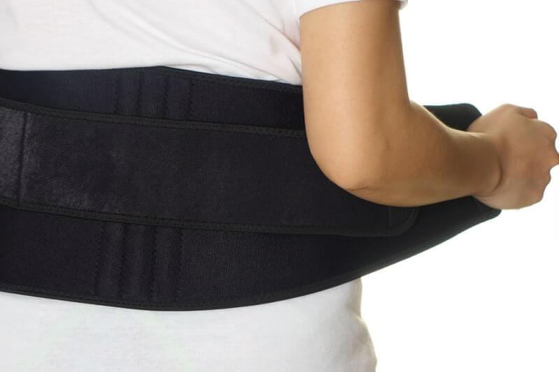 woman wearing back support belt