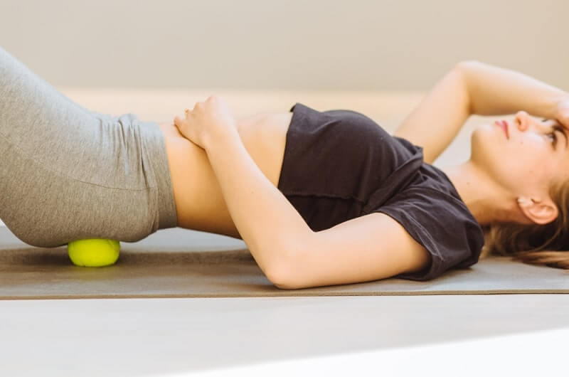 massage technique applying tennis balls for back pain relief