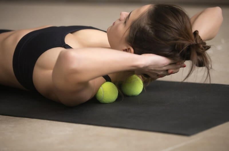 massage technique applying tennis balls for neck and shoulder pain relief